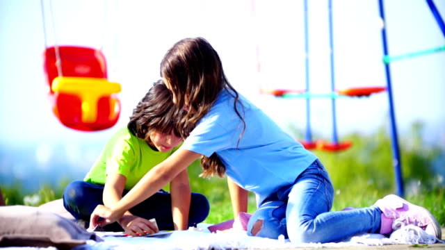 children playing board game outdoors. - draughts stock videos & royalty-free footage