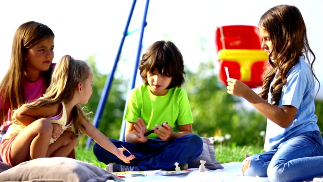 children playing board game outdoors. - board game stock videos & royalty-free footage