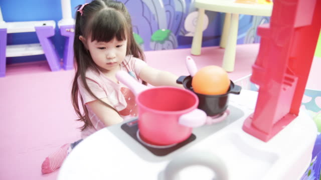 Children playing cooking toy