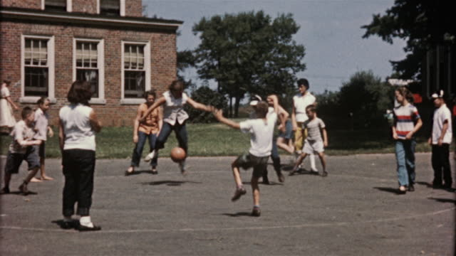 1956 ws children playing dodgeball / usa - school yard stock videos and b-roll footage