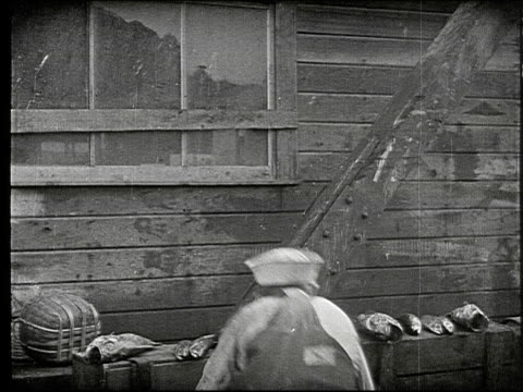 children playing games on wharf dock / old chinese man with basket on laundry on shoulder walks by / boys and adult dock workers surround and taunt... - sad old asian man stock videos & royalty-free footage