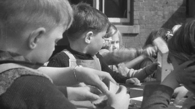 montage children playing games with matron and caretakers in world war ii day nursery / united kingdom - world war ii stock videos & royalty-free footage