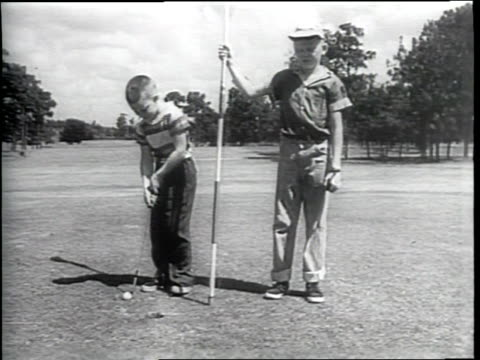 children playing golf / kid struggles to hit golf ball / kid hit golf ball / child misses put repeatedly / narrated - amateur stock videos & royalty-free footage