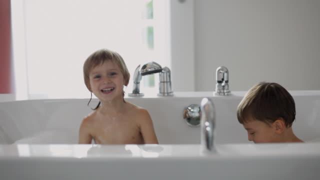 ms children (2-5) playing in bathtub / kleinmachnow, brandenburg, germany - bath stock videos and b-roll footage