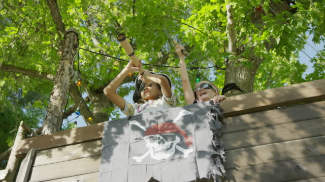 Children playing in pirate ship tree house / Provo, Utah, United States