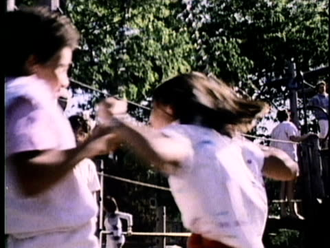 1986 montage children playing in playground and teenagers smoking cigarettes, usa, audio - 1980 stock videos and b-roll footage