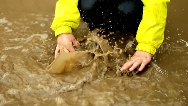 children playing in rain puddle - mud stock videos & royalty-free footage