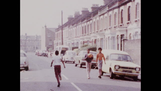 children playing in residential road in brixton; 1973 - dividing line stock videos & royalty-free footage