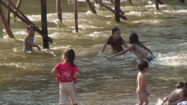 WS ZO Children playing in river, Luang Prabang, Laos