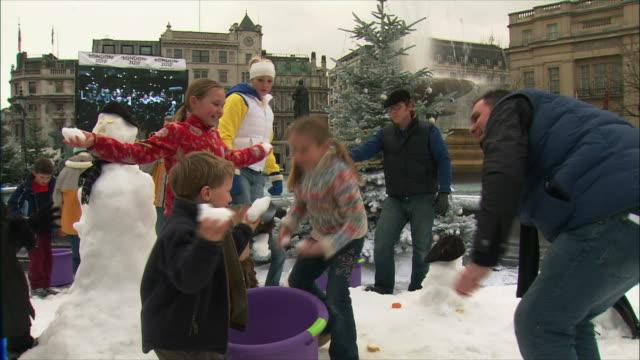 MS Children playing in snow at Trafalgar Square / London, United Kingdom