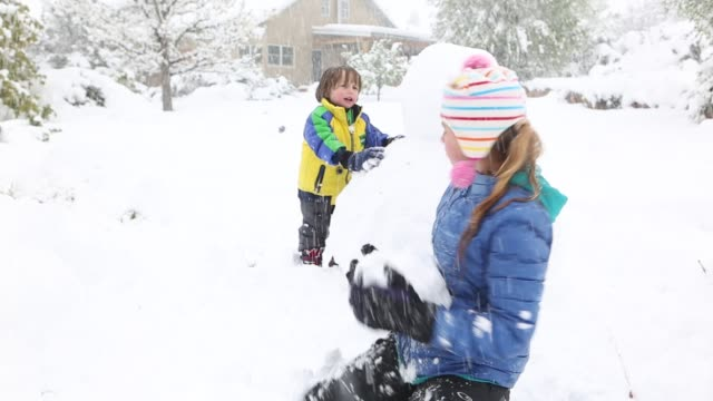 children playing in snow storm