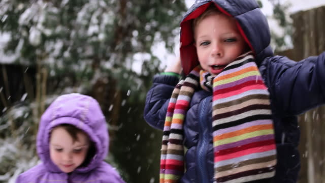 children playing in snow - focus on foreground stock videos & royalty-free footage