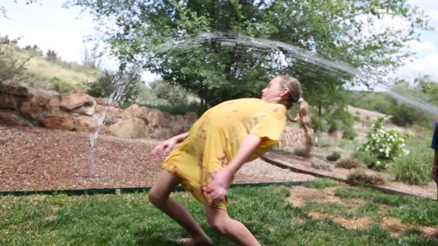 children playing in sprinkler - 10 seconds or greater stock videos & royalty-free footage