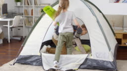 Children Playing in Tent at Home