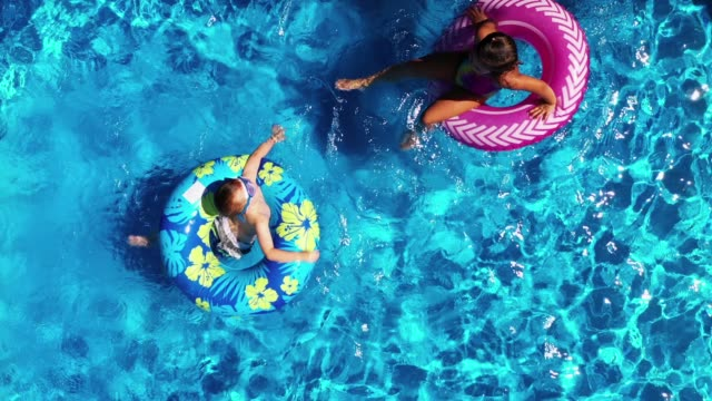 children playing in the pool in summer - recreational pursuit stock videos & royalty-free footage