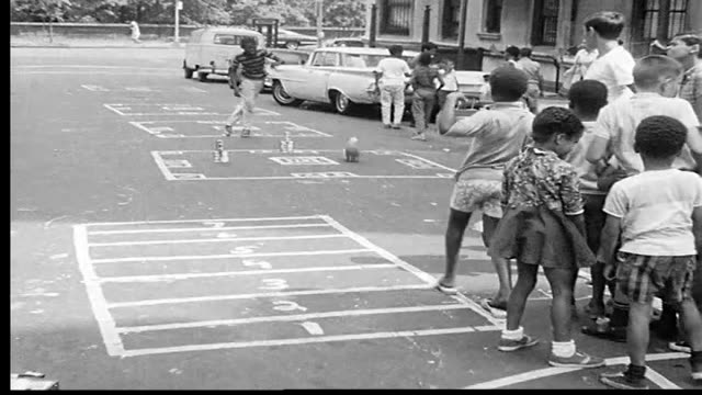 1968 children playing in the streets of new york city - moving activity stock videos & royalty-free footage