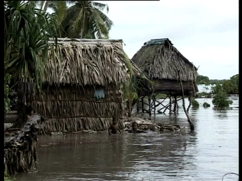 children playing in water surrounding hut, kiribati, central pacific - pacific islands stock videos & royalty-free footage