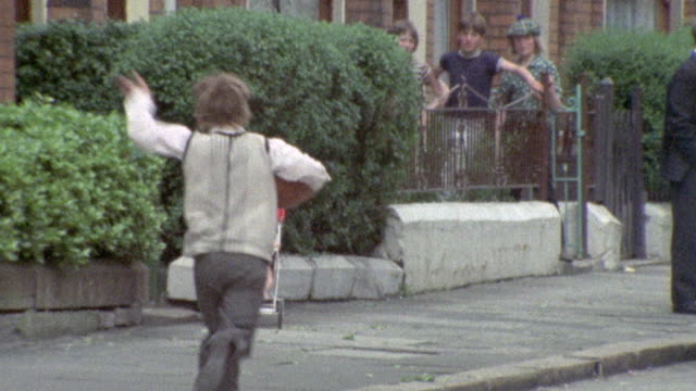 vídeos de stock, filmes e b-roll de 1973 montage children playing / northern ireland - 1973
