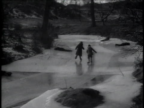 1947 montage children playing on a frozen pond - ice skating stock videos & royalty-free footage