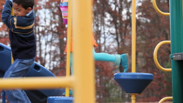 ms pan children playing on playground equipment / richmond, virginia, usa - obstacle course stock videos & royalty-free footage