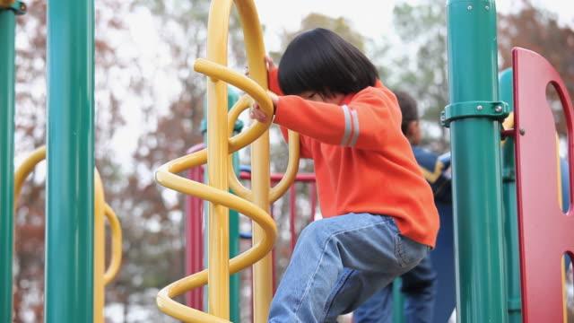 MS PAN Children playing on playground equipment / Richmond, Virginia, USA