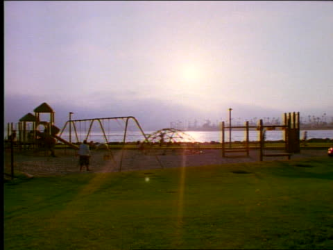 children playing on playground equipment - see other clips from this shoot 1158 stock videos & royalty-free footage