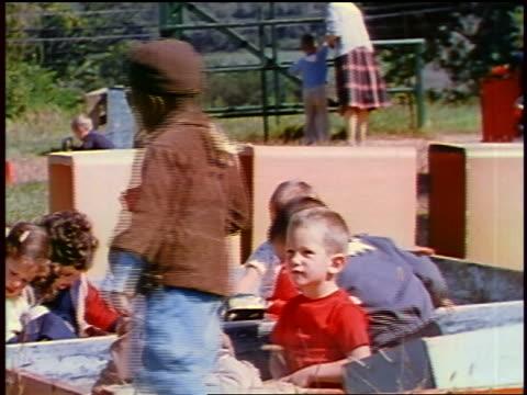 vídeos y material grabado en eventos de stock de 1957 children (one black) playing on playground / feature - 1957