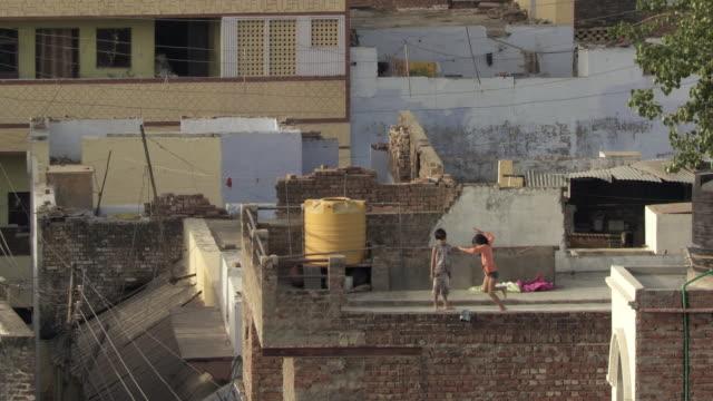ms ha children playing on rooftop / agra, uttar pradesh, india - agra video stock e b–roll
