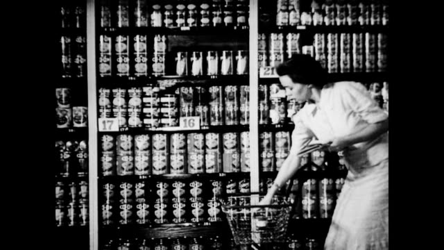 stockvideo's en b-roll-footage met / children playing on sidewalk outside grocery store as their mother's shop / housewife shopping in grocery store pulling canned food off shelf and... - 1930 1939