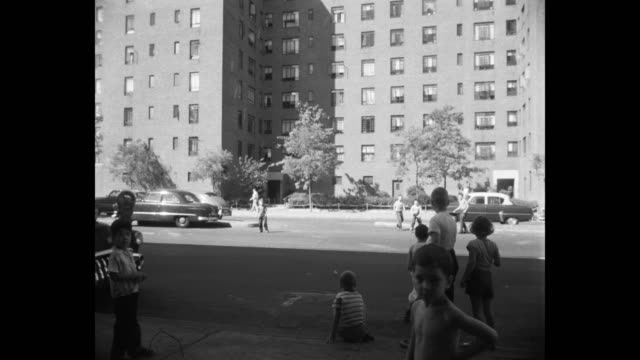 1952 children playing on street, stuyvesant town, new york city, new york state, usa - 1950 stock videos & royalty-free footage