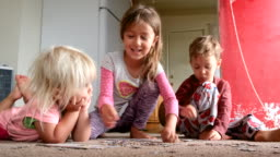 Children playing on the floor solving a puzzle