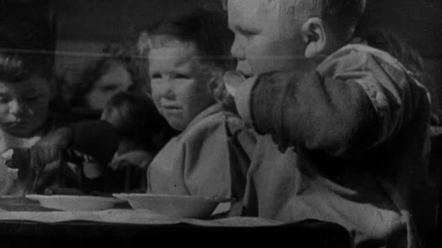 1941 montage children playing on the school ground and lining up to see a performance, at the greatest danger for exposure to diphtheria in crowds and school / united kingdom - diphtherie stock-videos und b-roll-filmmaterial