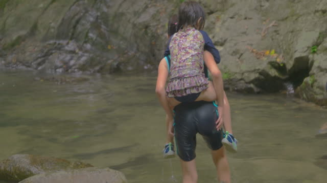 children playing outdoors. at the mountain river. - piggyback stock videos and b-roll footage