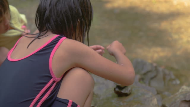 children playing outdoors. at the mountain river. - タオル点の映像素材/bロール