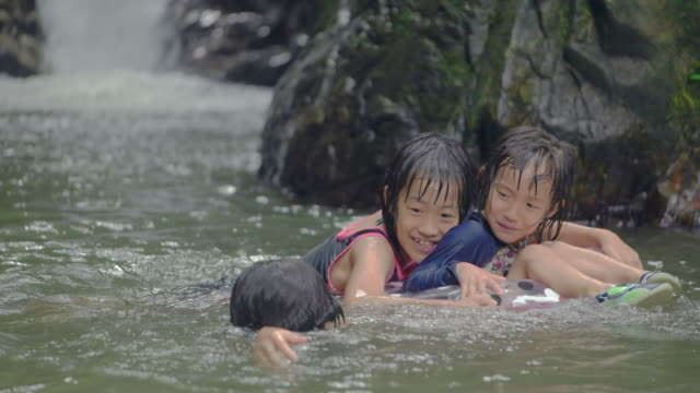 Children playing outdoors. at the mountain river.