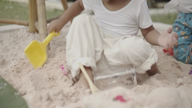 children playing outside on the dirt ground. - 2 kid in a sandbox stock videos and b-roll footage