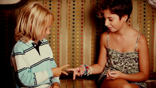 children playing rock paper scissors - sibling stock videos and b-roll footage