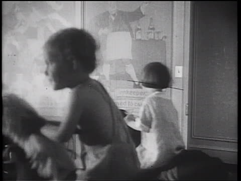 B/W 1934 PAN children playing + rocking on rocking horses in playroom on cruise ship