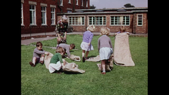 montage children playing sack race at school for the deaf in united kingdom - sack race stock videos & royalty-free footage