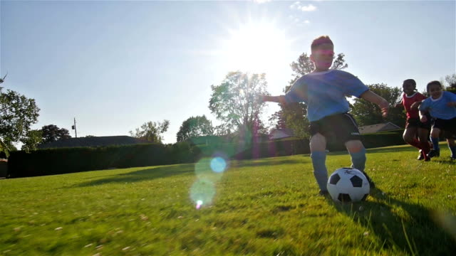 stockvideo's en b-roll-footage met children playing soccer - kind