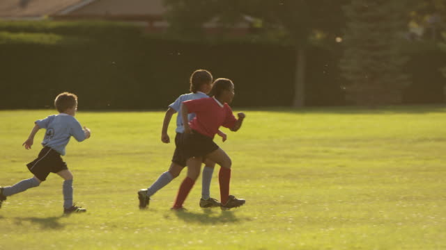children playing soccer - school child stock videos & royalty-free footage