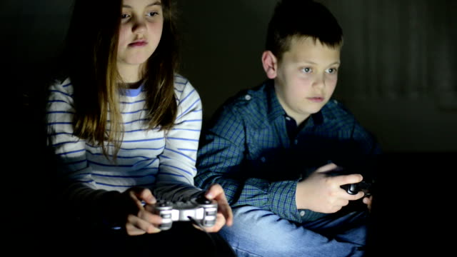 children playing video games - leisure games stock videos & royalty-free footage