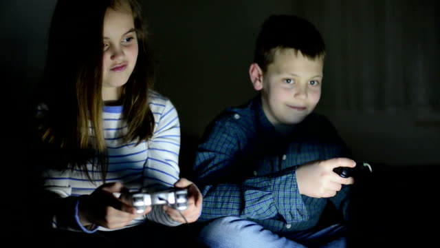 children playing video games - handheld video game stock videos & royalty-free footage