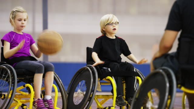 children playing wheelchair basketball - basketball sport stock videos & royalty-free footage