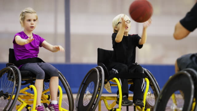children playing wheelchair basketball - disability stock videos & royalty-free footage
