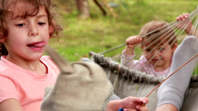 children playing with a hammock in the backyard - lingua umana video stock e b–roll