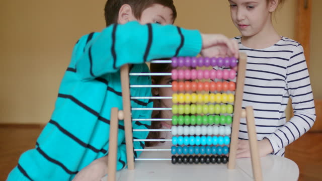 Children playing with abacus, slow motion