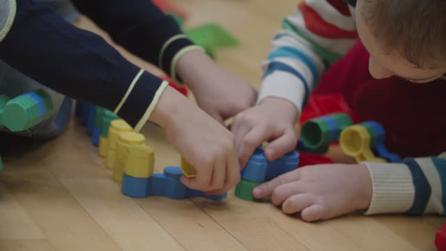 4k: children playing with blocks in kindergarten. - preschool stock videos and b-roll footage