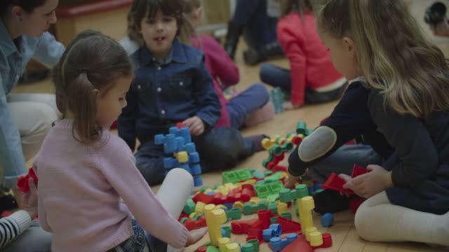 4K: Children Playing With Blocks In Kindergarten.