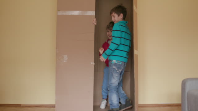 children playing with cardboard box - hide and seek stock videos & royalty-free footage